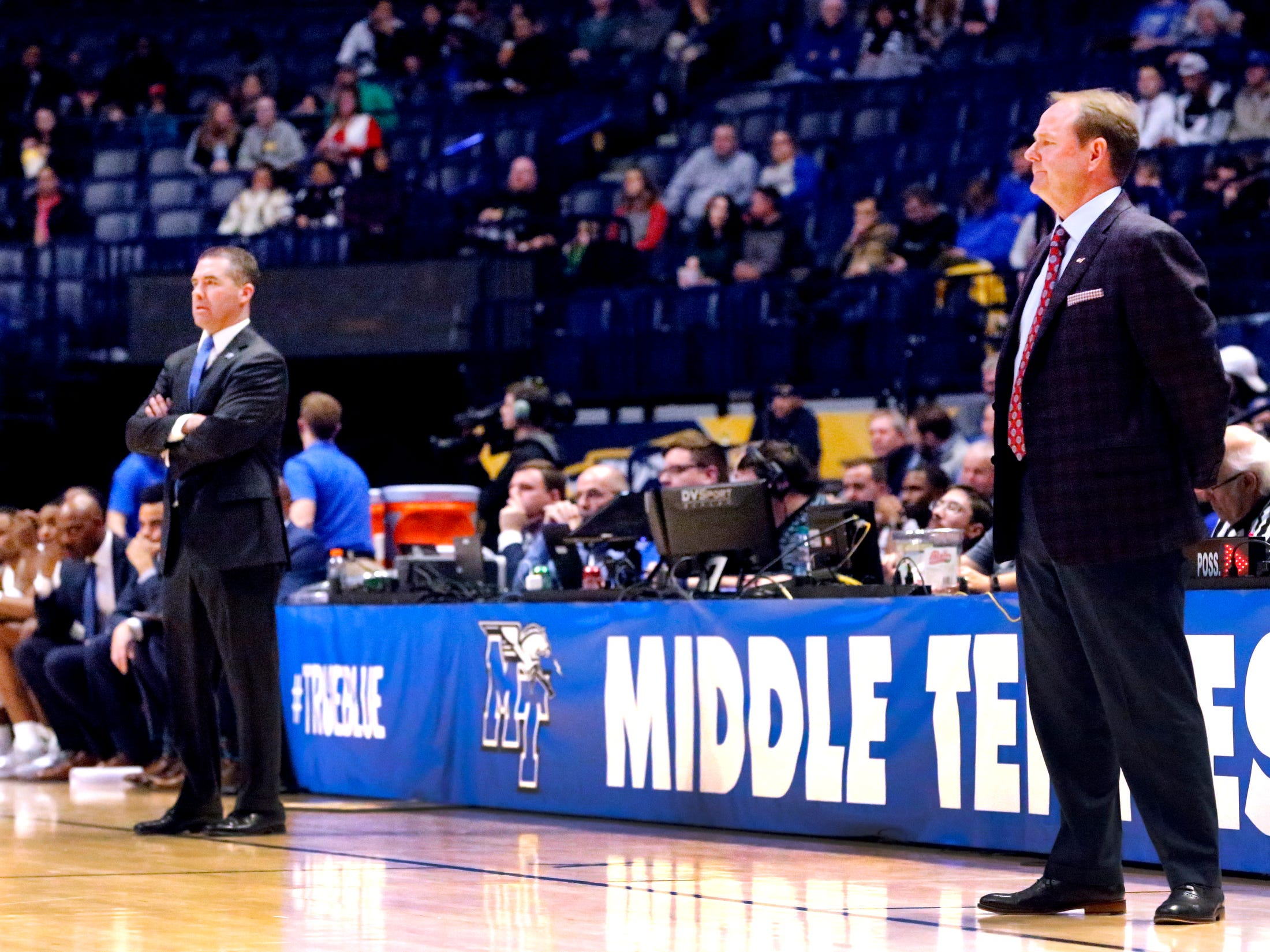Ole Miss' head coach Kermit Davis, right, stands on the sidelines as MTSU's head coach Nick McDevitt also watches the game from the sidelines on Friday Dec. 21, 2018, at Bridgestone Arena. Davis was the former MTSU Mens coach.