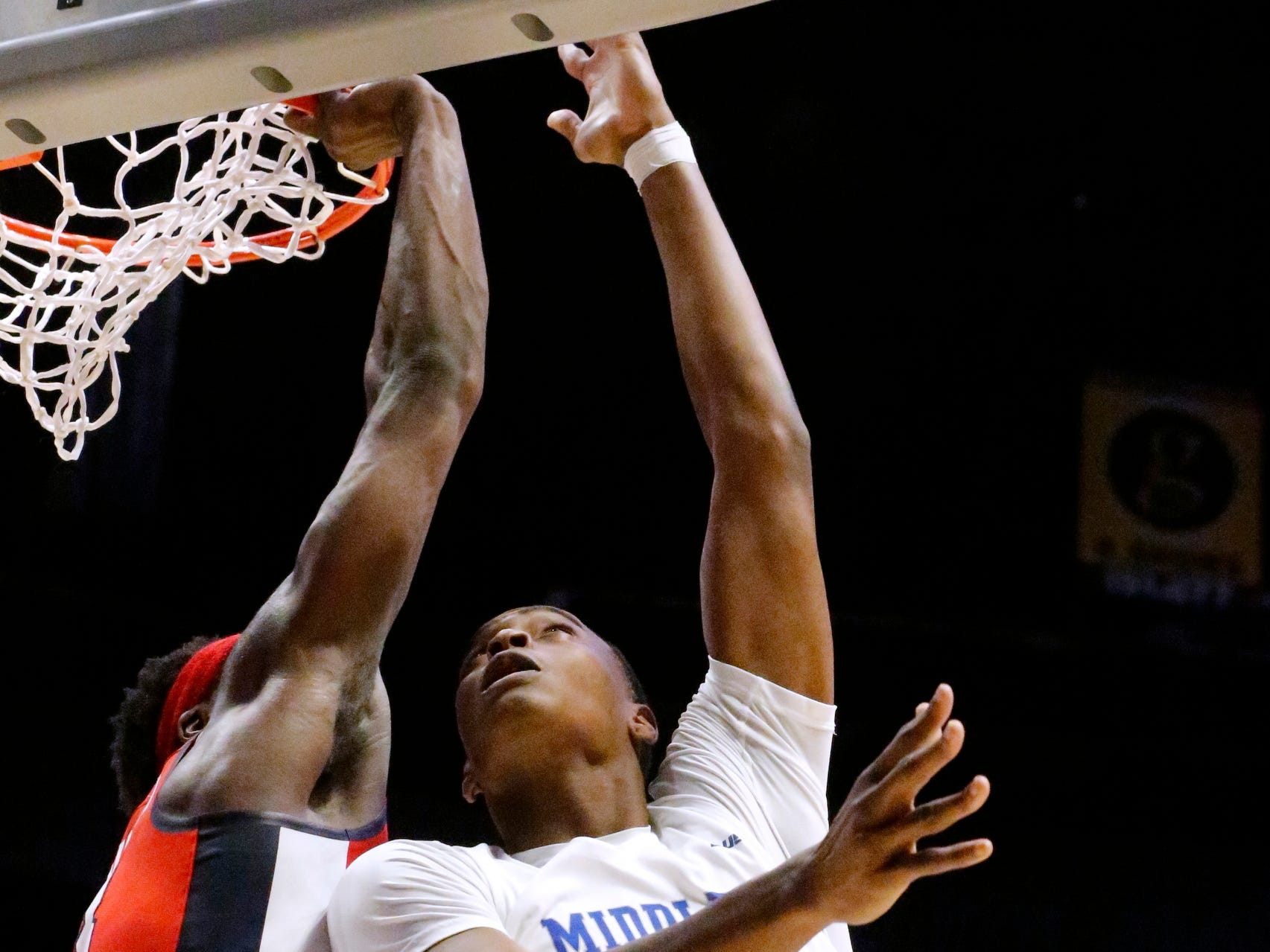 MTSU's forward Karl Gamble (25) goes up for a shot a Ole Miss' guard Terence Davis (3) defends him on Friday Dec. 21, 2018, at Bridgestone Arena.