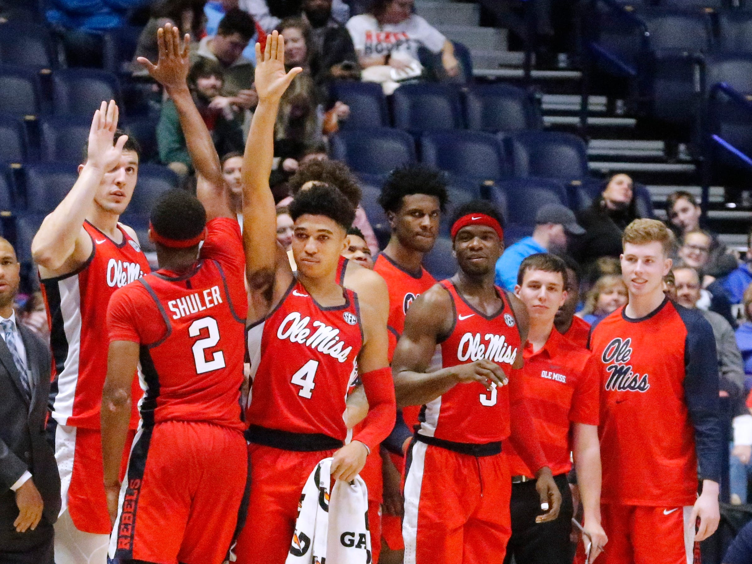 The Ole Miss bench celebrates with Ole Miss' guard Devontae Shuler (2) as he comes out of the game against MTSU on Friday Dec. 21, 2018, at Bridgestone Arena.