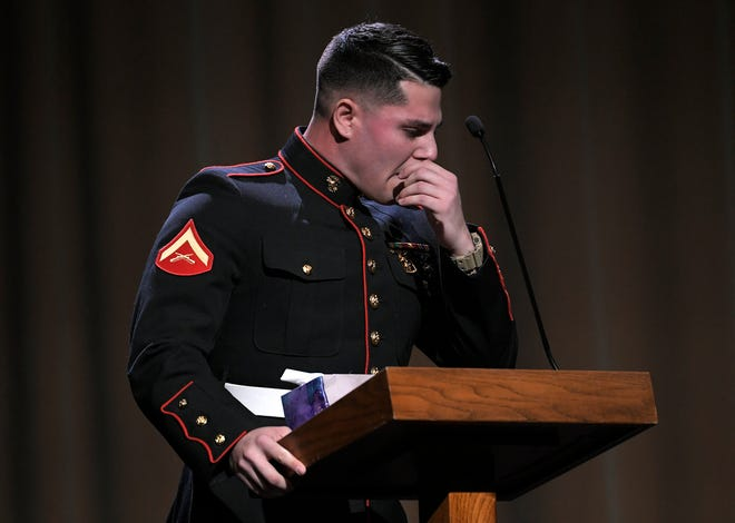 """John Ferraro becomes emotional while speaking during a celebration of life for his friend William """"Carter"""" Ross at Longhollow Baptist Church in Hendersonville on Saturday, Dec. 22, 2018.  Ross, a Marine and Hendersonville, Tenn., resident, is believed to be among those declared dead after fighter jets collided and crashed into the Pacific Ocean off Japan's coast on Dec. 6, 2018."""