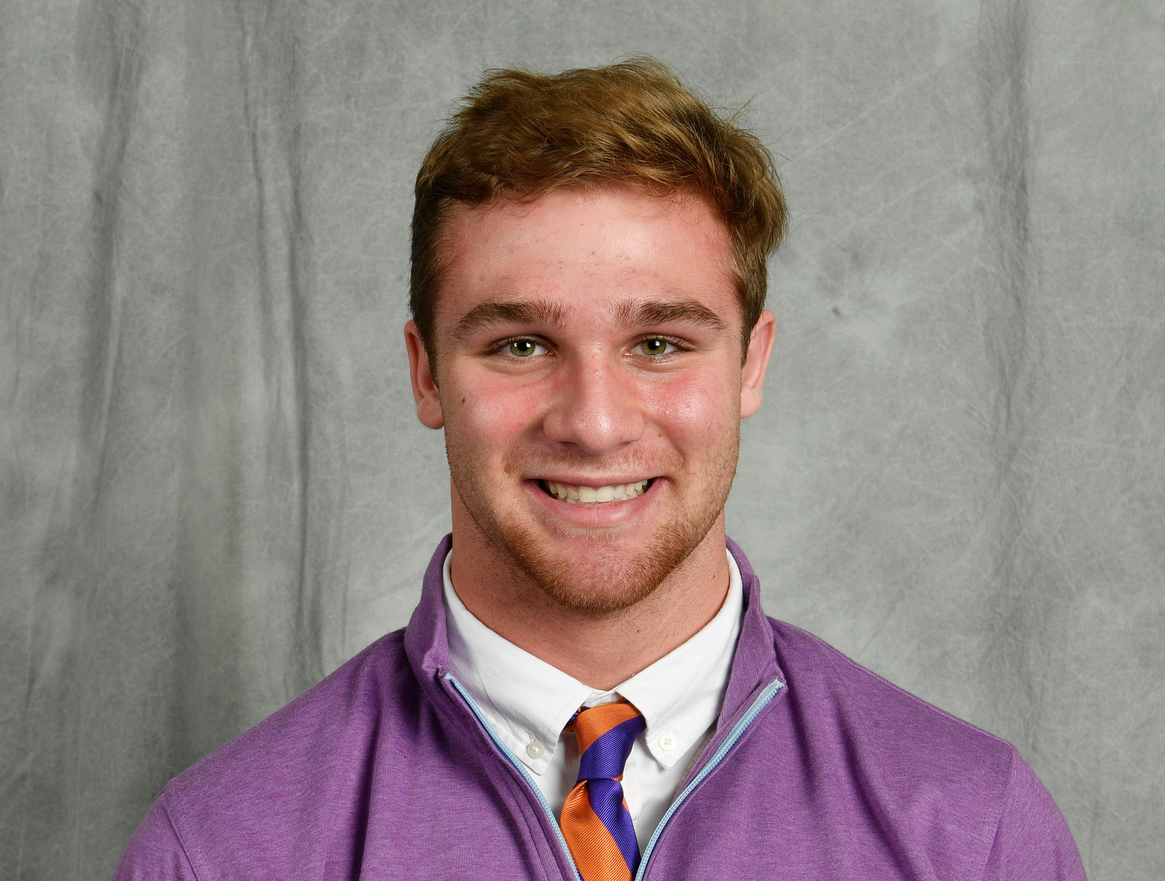 CPA senior Kane Patterson, a Clemson signee poses for a picture in the Tennessean's photo both on early signing day.