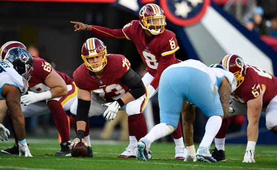 Josh Johnson (8) gives directions to his team in the first quarter at Nissan Stadium, Dec. 22, 2018, in Nashville, Tenn.