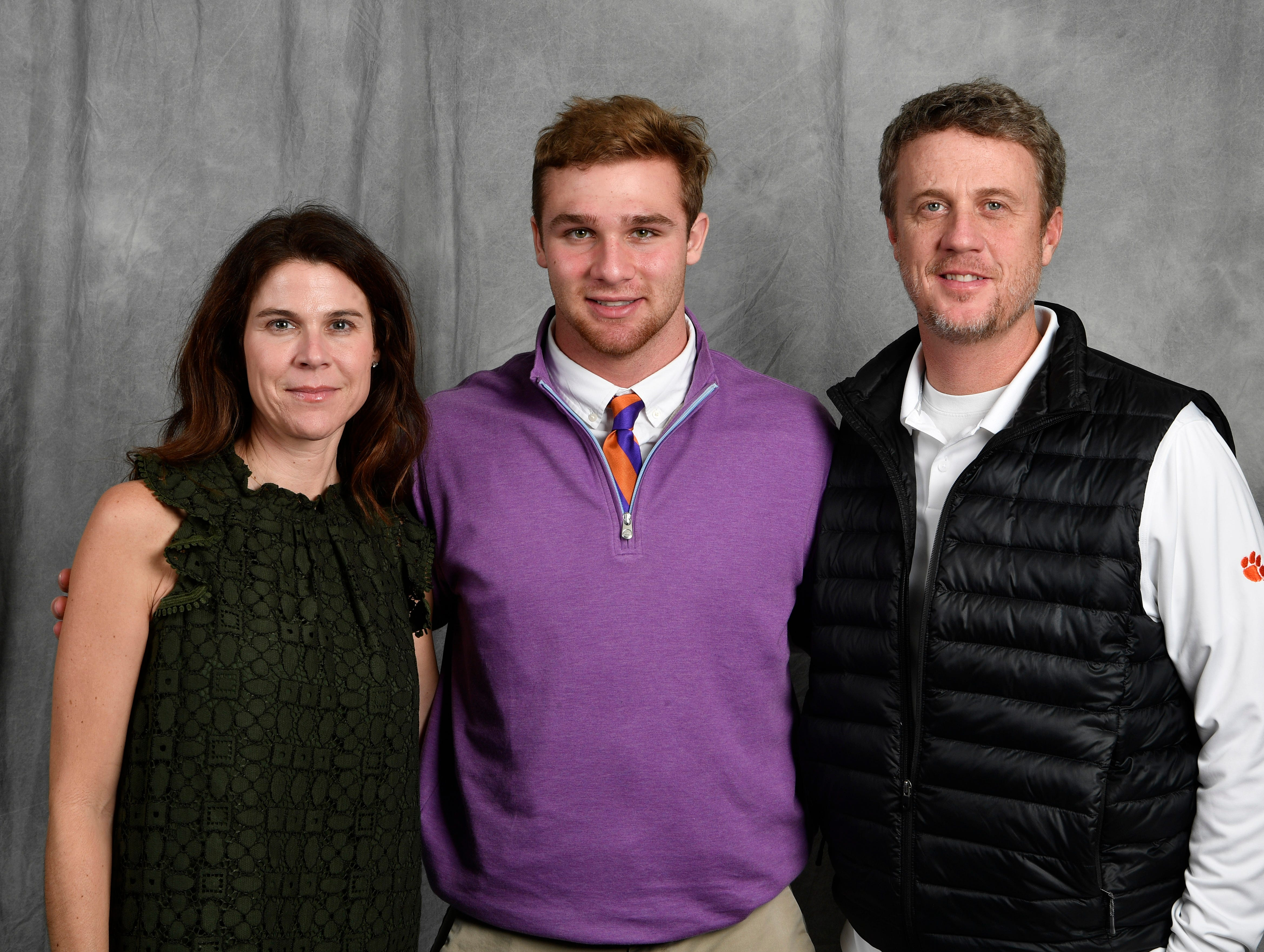 CPA senior Kane Patterson poses with his parents Camille and Wes Patterson Wednesday in the Tennessean's photo booth.