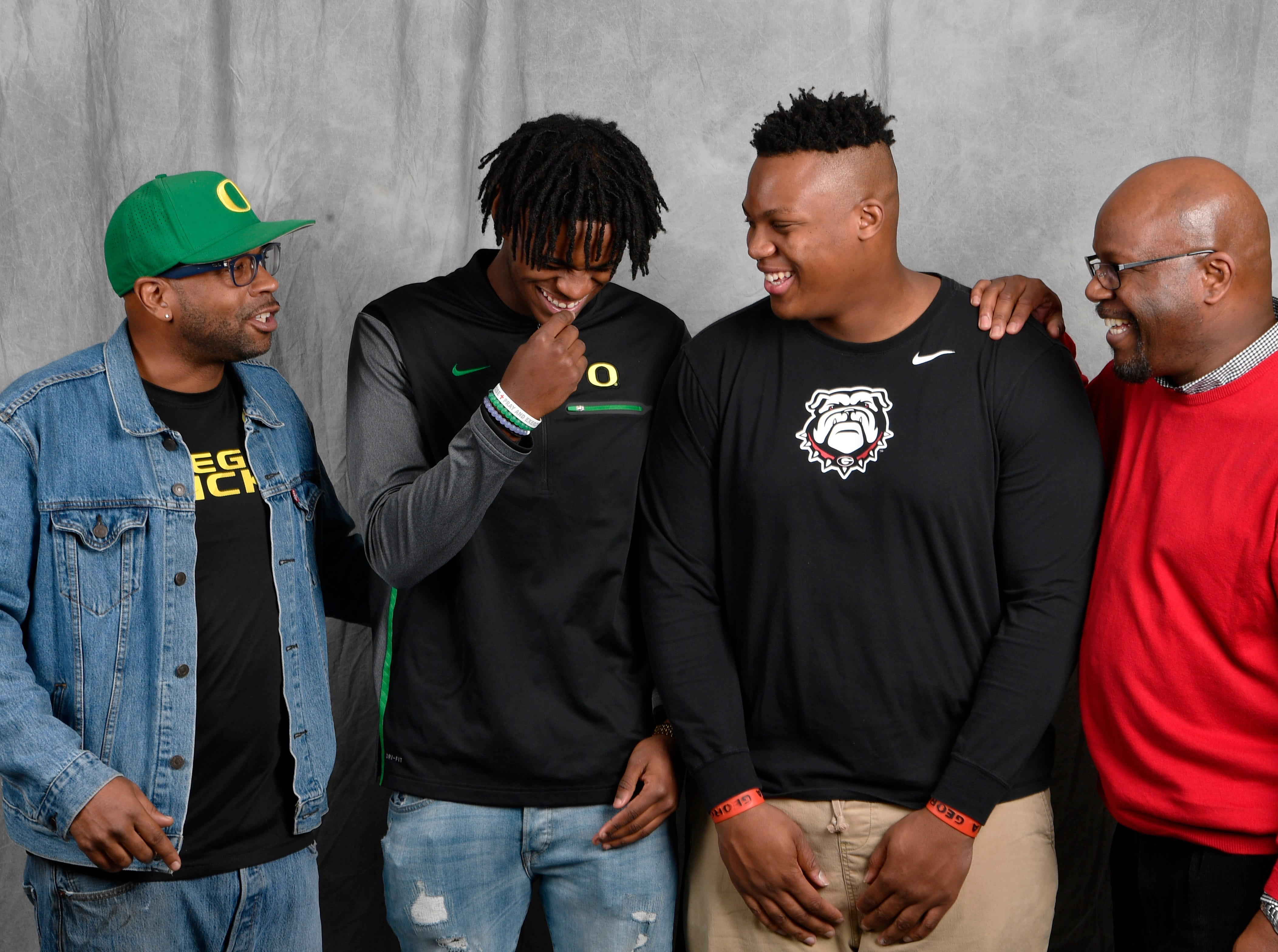 FRA's Lance Wilhoite and Tymon Mitchell pose with their dads in the Tennessean's photo booth on the first day of the early signing period. From left, are Larry Wilhoite, Lance Wilhoite, Tymore Mitchell and Dale Mitchell. Lance signed with Oregon to play football while Tymon signed with Georgia.
