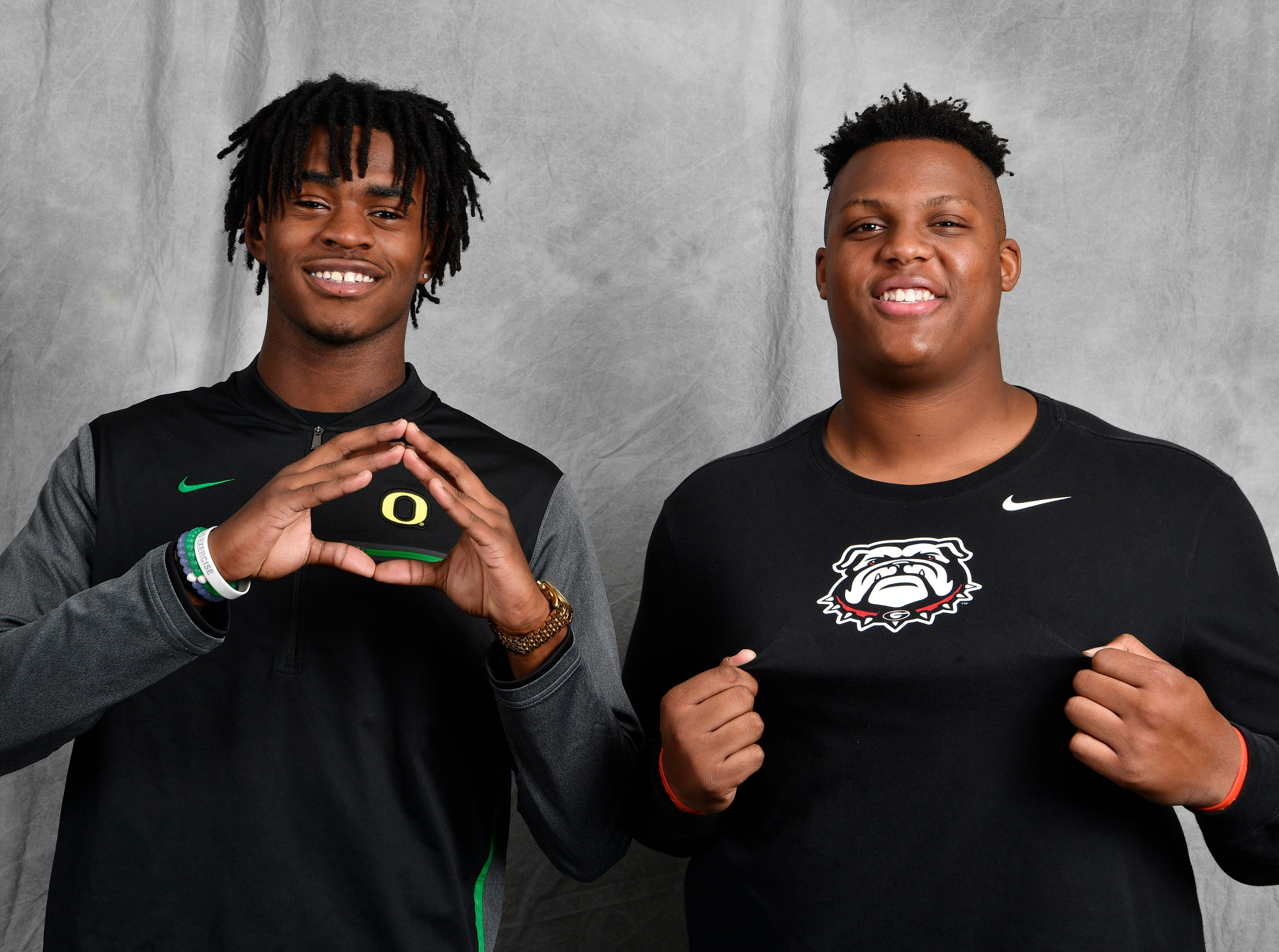 FRA teammate's Lance Wilhoite, left, and Tymon Mitchell pose for a picture in the Tennessean's photo booth on Wednesday on the first day of the early signing period. Wilhoite signed with Oregon while Mitchell is going to Georgia.