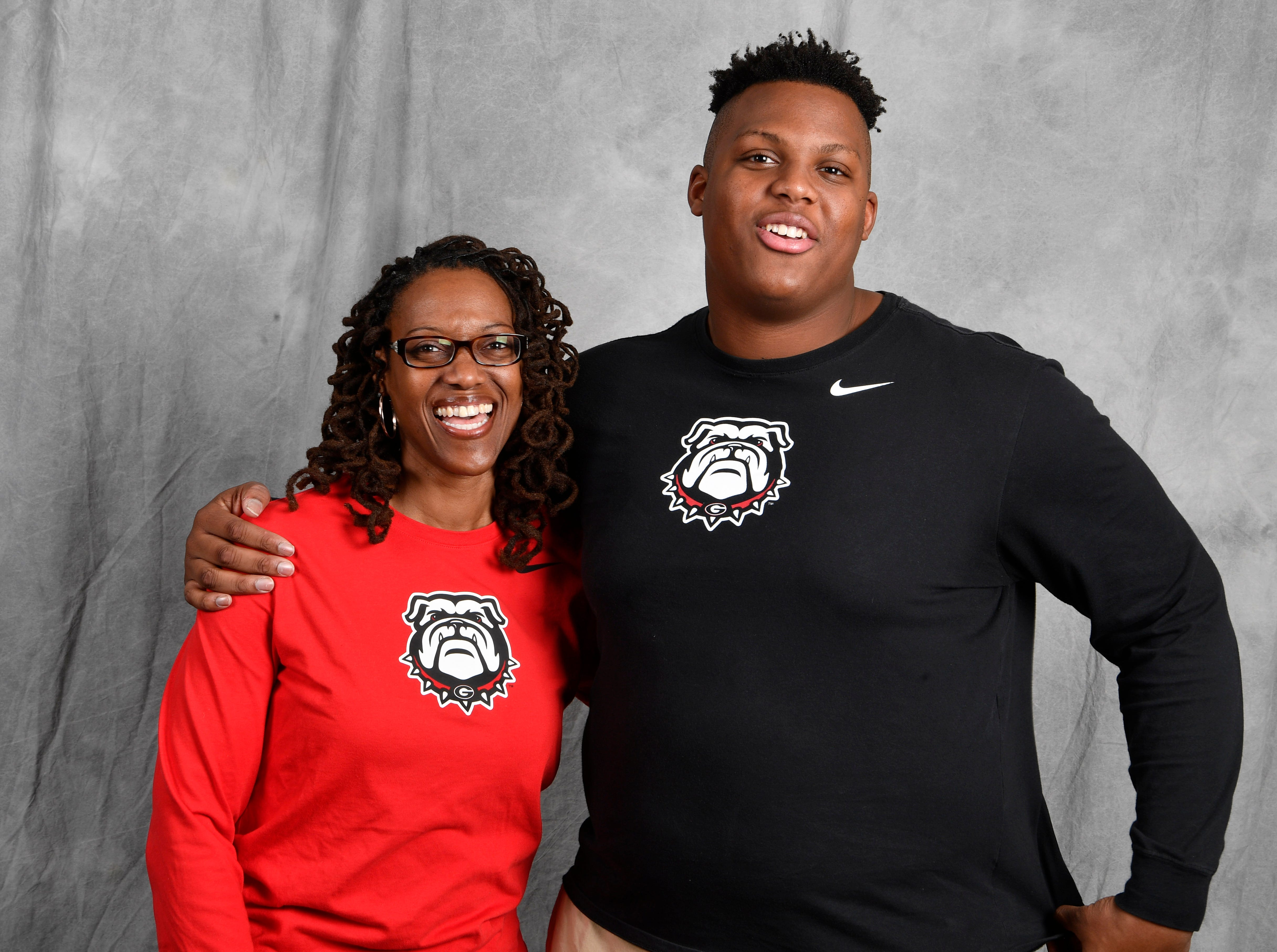 FRA's Tymon Mitchell, left, signed with Georgia on Wednesday to play football. He is pictured with his mom Andrea McClain.