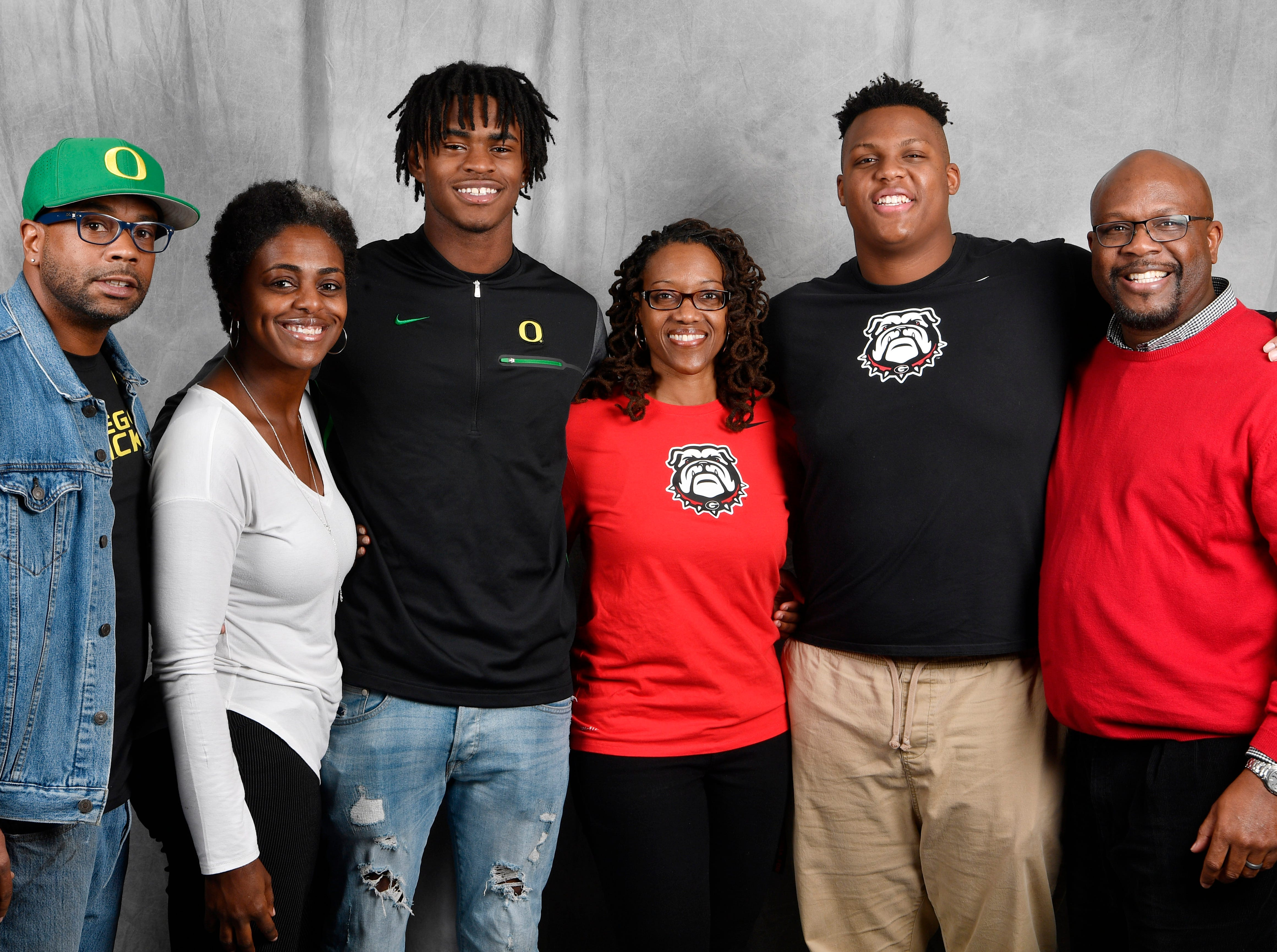 FRA's Lance Wilhoite and teammate Tymon Mitchell pose for a picture with their parents. From left, are Larry Wilhoite, Travonya Wilhoite, Lance Wilhoite, Andrea McClain, Tymon Mitchell and Dale Mitchell.