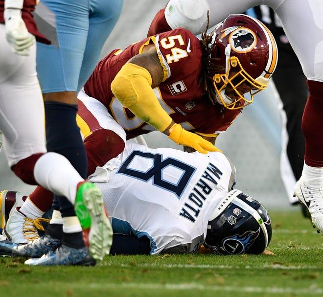 Titans quarterback Marcus Mariota (8) is sacked in the second quarter Saturday.