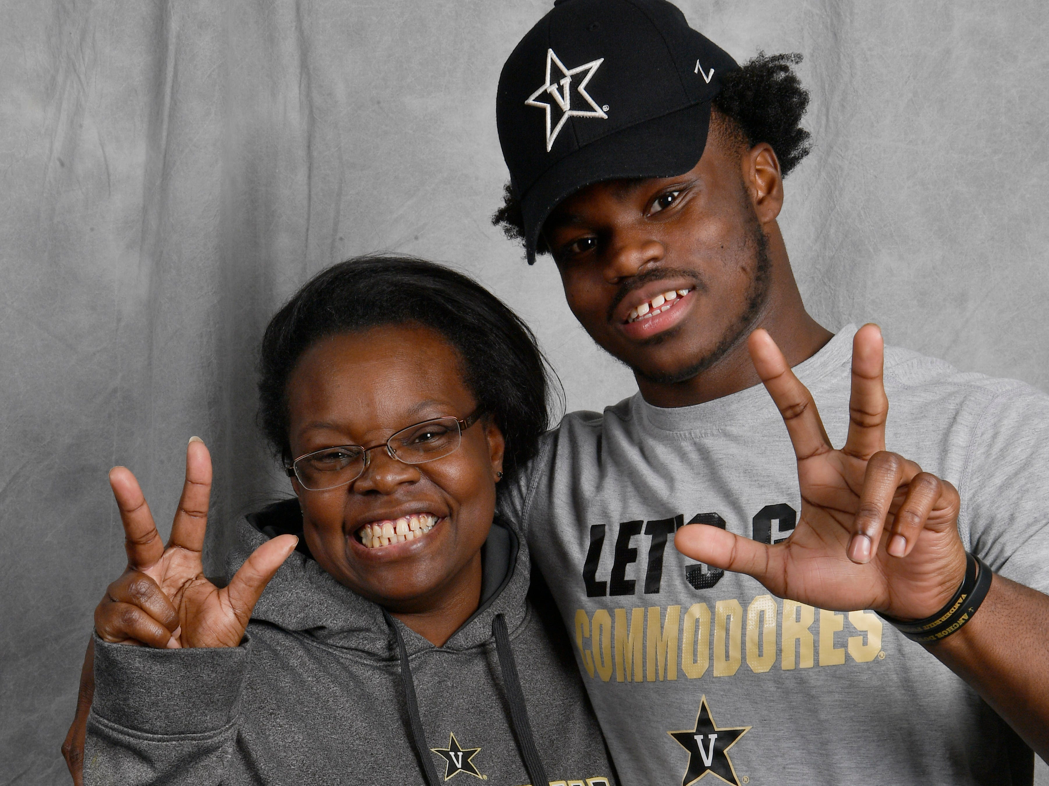 Vanderbilt signee Jayden Harrison, a Pearl-Cohn senior, poses with his mom Kimberly Harrison on Wednesday in the Tennessean's photo booth.