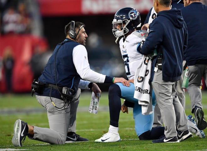 Titans head coach Mike Vrabel talks to quarterback Marcus Mariota (8) after he was injured in the second quarter at Nissan Stadium Saturday, Dec. 22, 2018, in Nashville, Tenn.