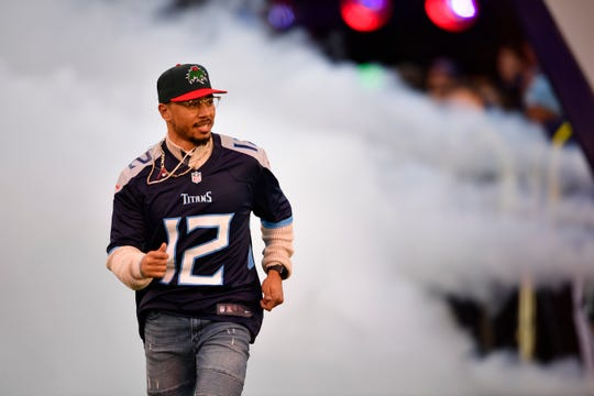 Red Sox star and American League MVP Mookie Betts, an Overton High graduate, takes the field as the Titans 12th man before the game at Nissan Stadium Saturday, Dec. 22, 2018, in Nashville, Tenn.