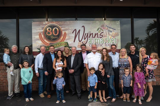 Three generations of the Wynn family stand outside their store in Naples.