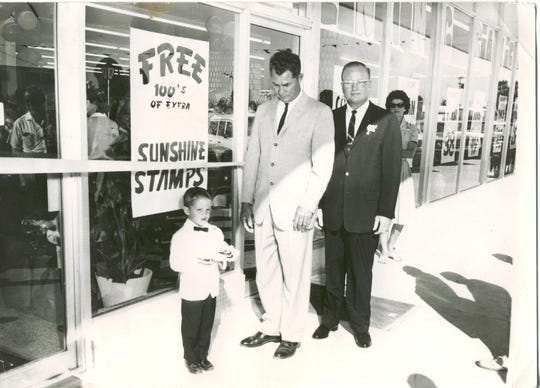 A young Tim Wynn, with his father, Don, and former Naples Mayor Archie Turner.