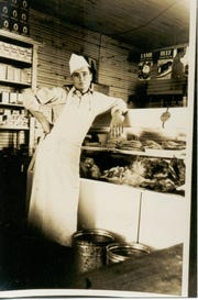 A young Tim Wynn at the meat counter at Wynn's Market.