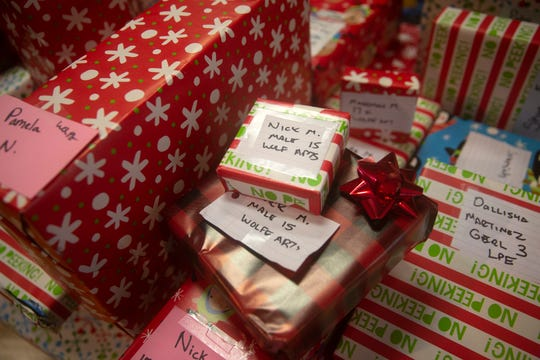 Gifts for children in the Naples community are wrapped and ready to be given out during a charitable event hosted by the Fraternal Order of Police, Lodge 38 at the River Park Community Center, Saturday, Dec. 22, 2018 in Naples.