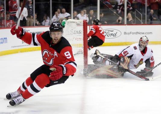 Aptopix Senators Devils Hockey