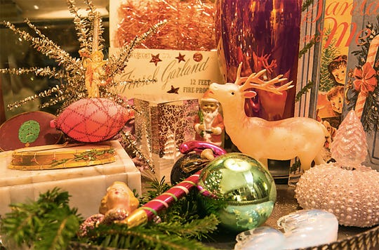 Creative vignettes of ornaments and decorations, like this tabletop of pink and green Christmas collectibles, is a favorite way for Richter to display pieces of his collection, which he estimates exceeds 2,500 ornaments and decorations, both passed down and found.