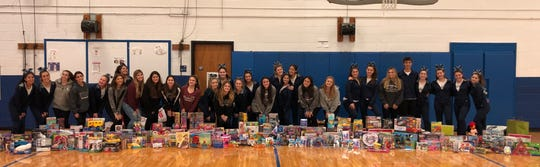 Wayne Valley and Wayne Hills cheerleading teams collected toys for the kids at Hackensack University Medical Center.