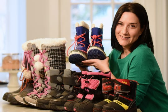 Tamara Freuman and the Tristate Jewish Network for Refugee Support are currently collecting winter boots for newly arrived refugees in Albany through the winter season. Shown in her Nyack home on Saturday December 22, 2018.