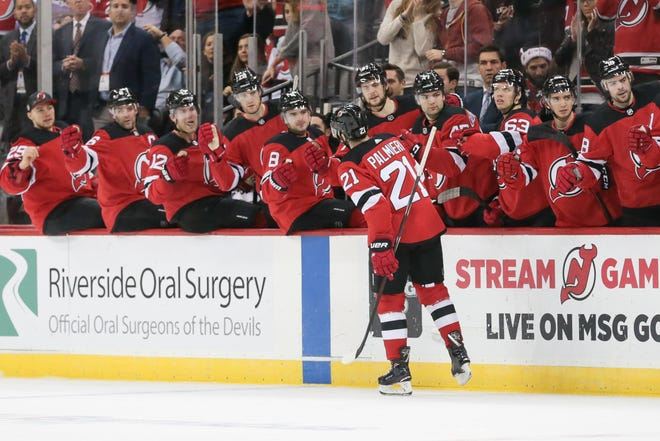 New Jersey Devils right wing Kyle Palmieri (21) celebrates with teammates after scoring a goal against the Ottawa Senators during the first period at Prudential Center.