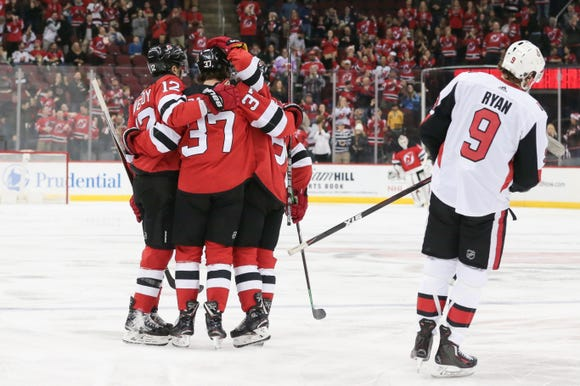 Dec 21, 2018; Newark, NJ, USA; New Jersey Devils center Pavel Zacha (37) celebrates with teammates in front of Ottawa Senators right wing Bobby Ryan (9) after scoring a goal during the first period at Prudential Center.