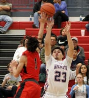 Wildcat post Demetri Maldonado (23) managed eight points against Bayard Cobre High before fouling out in the fourth quarter of Friday's home game.