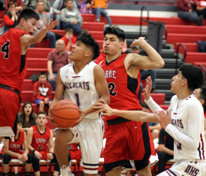 Jordan Caballero (1) dropped 8 of his 11 points in the second quarter to help the Deming Wildcats to a 38-26 half time lead over the visiting Cobre High Indians of Bayard, NM on Friday. The 'Cats held off the Grant County Tribe during a frenzied fourth quarter for a 62-58 victory.