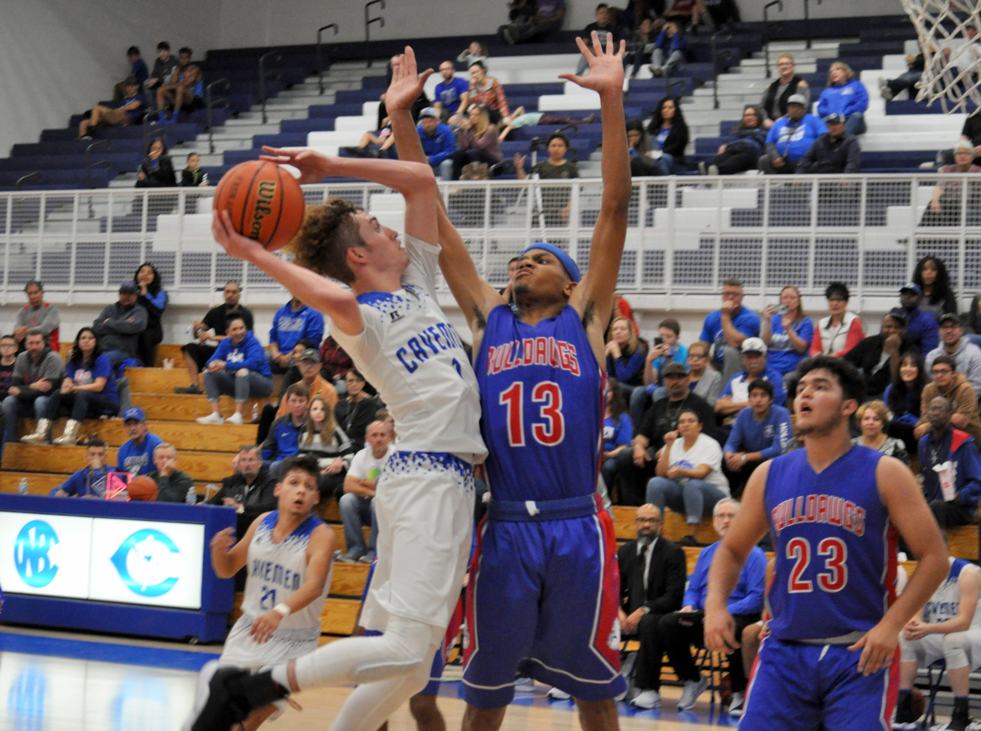 Carlsbad's Josh Sillas goes for a layup while Las Cruces' Ray Brown goes for a block. Both men lead their teams with 19 points during Friday's game.