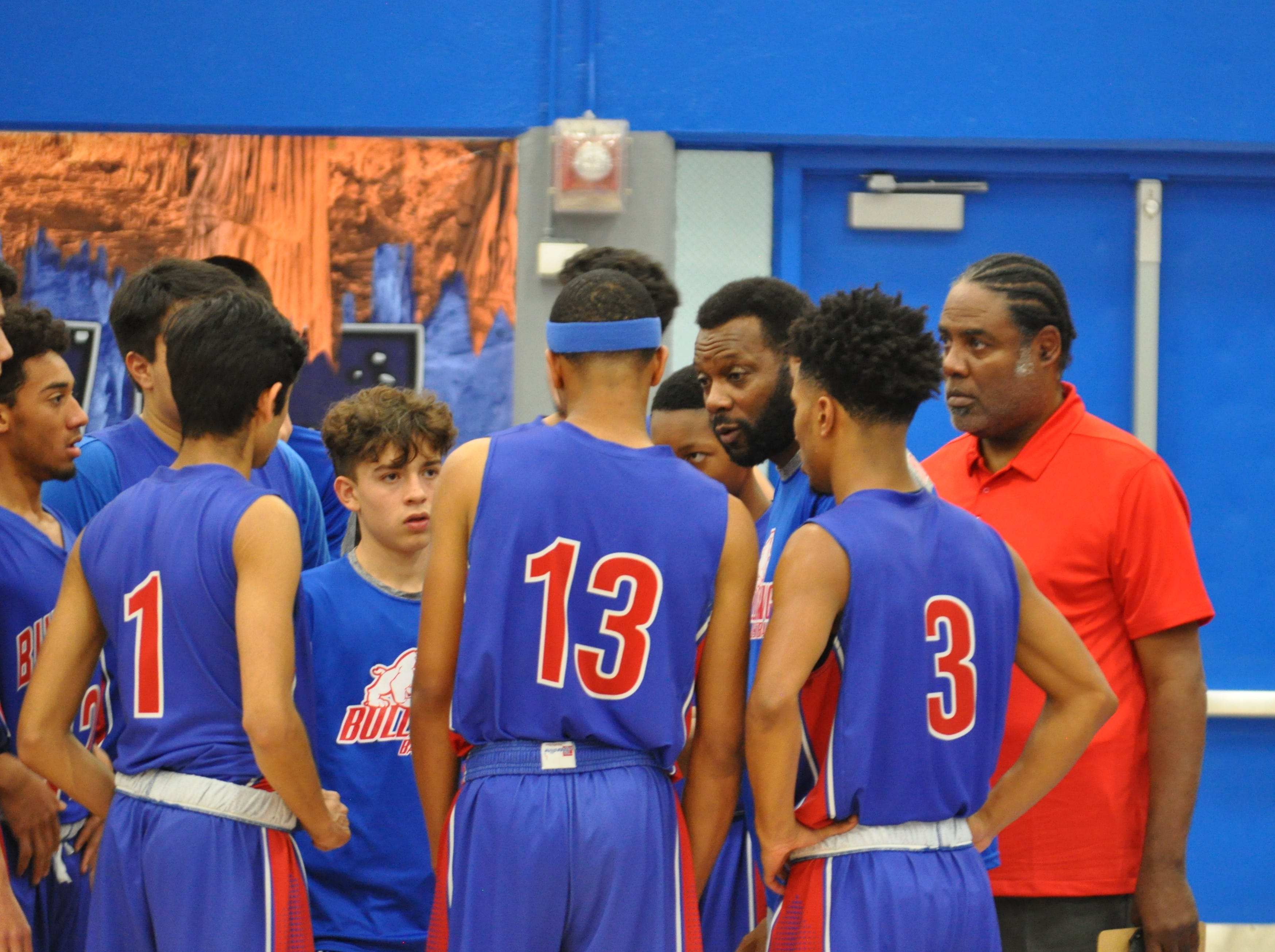 Las Cruces head coach William Benjamin talks to his team during Friday's game against Carlsbad.