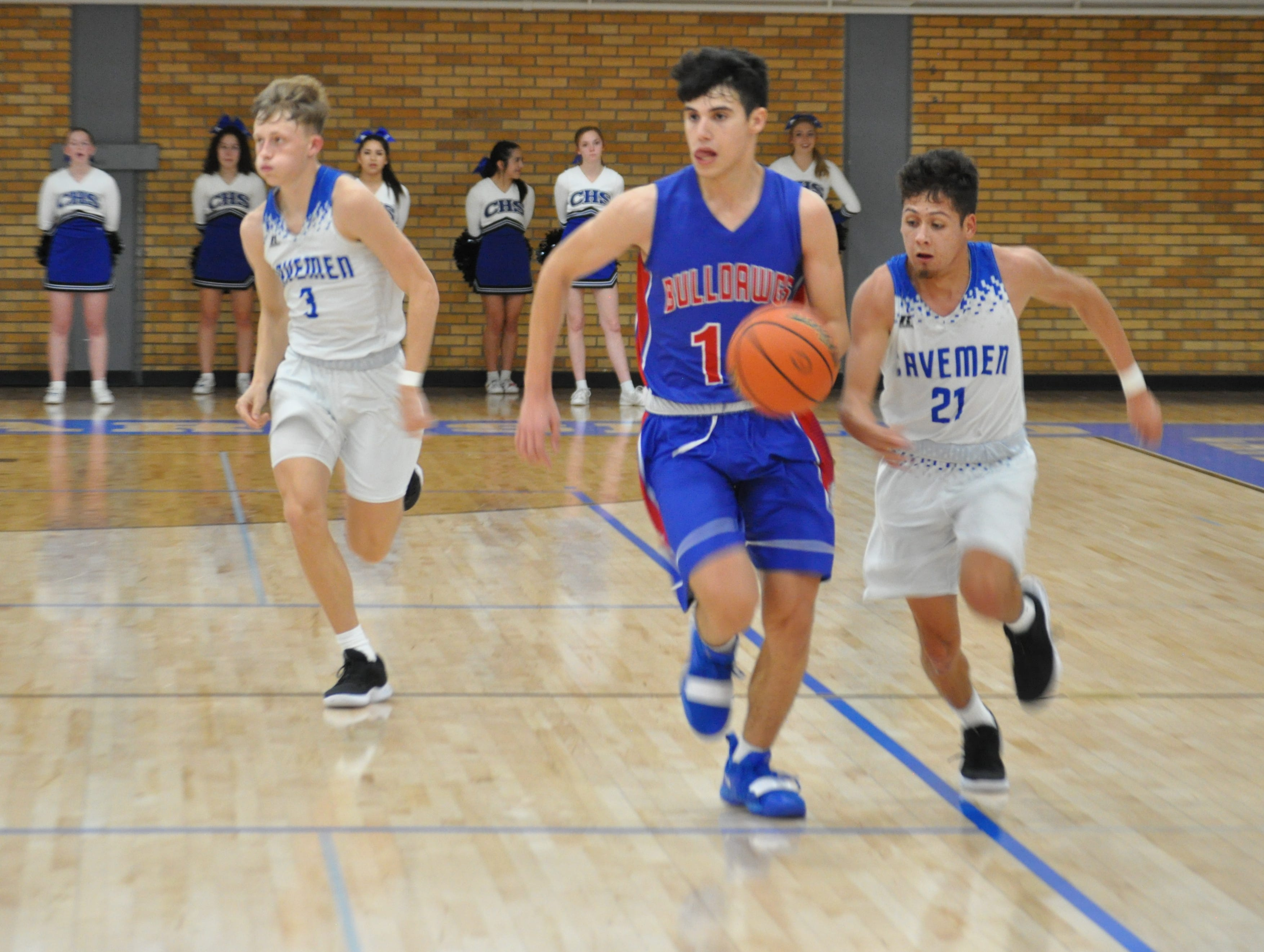 Gonzalo Corbalan starts a fastbreak while Carlsbad's Patrick Espinosa (21) goes for a steal during Friday's game.