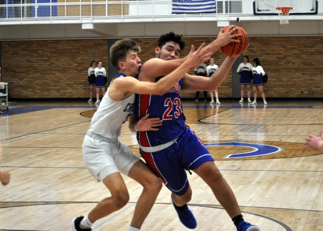 Las Cruces' Sal Nevarez (23) gets by Carlsbad's Stevie Bartlett during Friday's game.