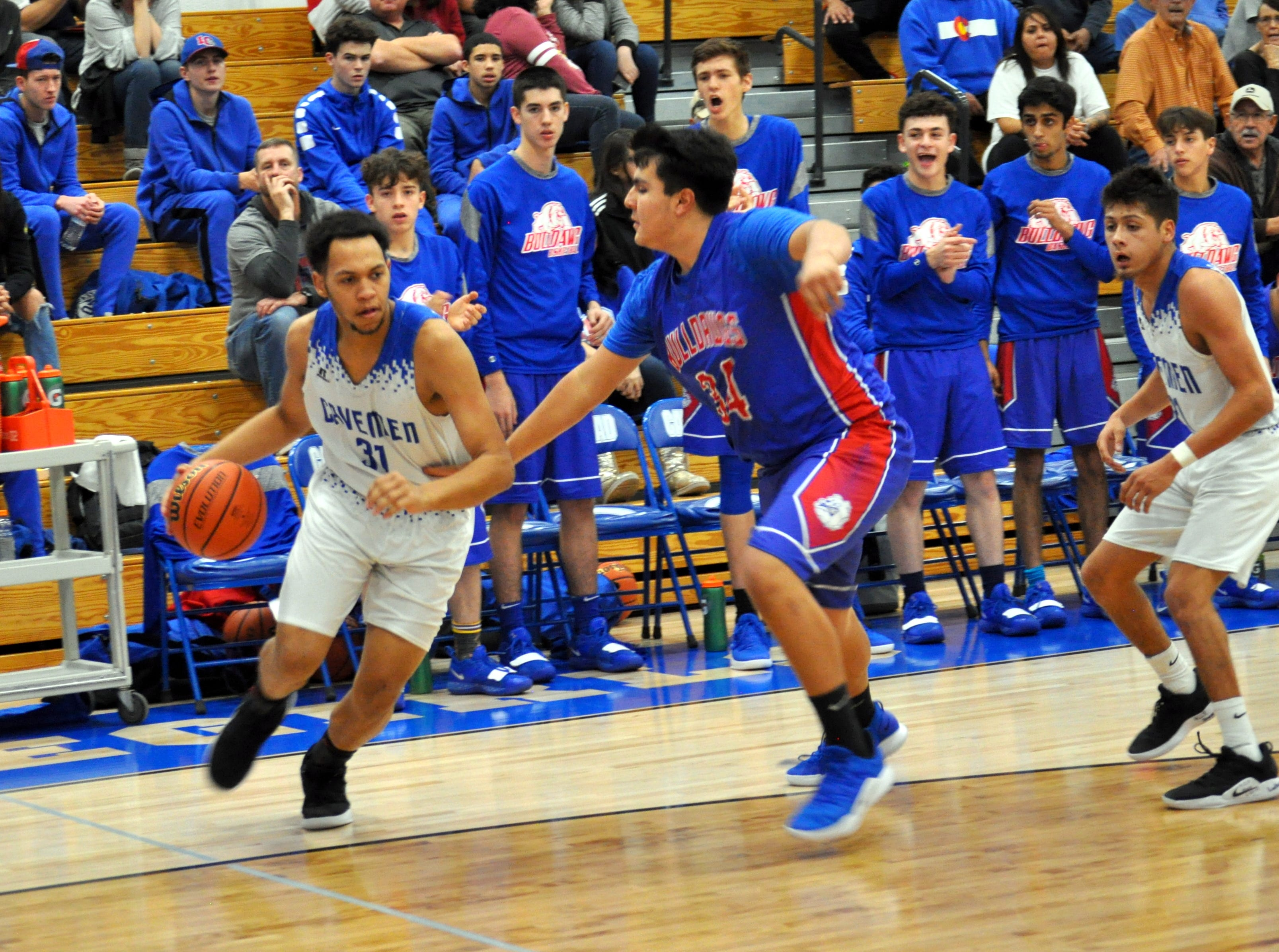 Carlsbad's Phillip Lee drives against Las Cruces' Josiah Montoya during Friday's game.