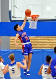 Gonzalo Corbalan (10) throws down a fastbreak dunk during Friday's game against Carlsbad.