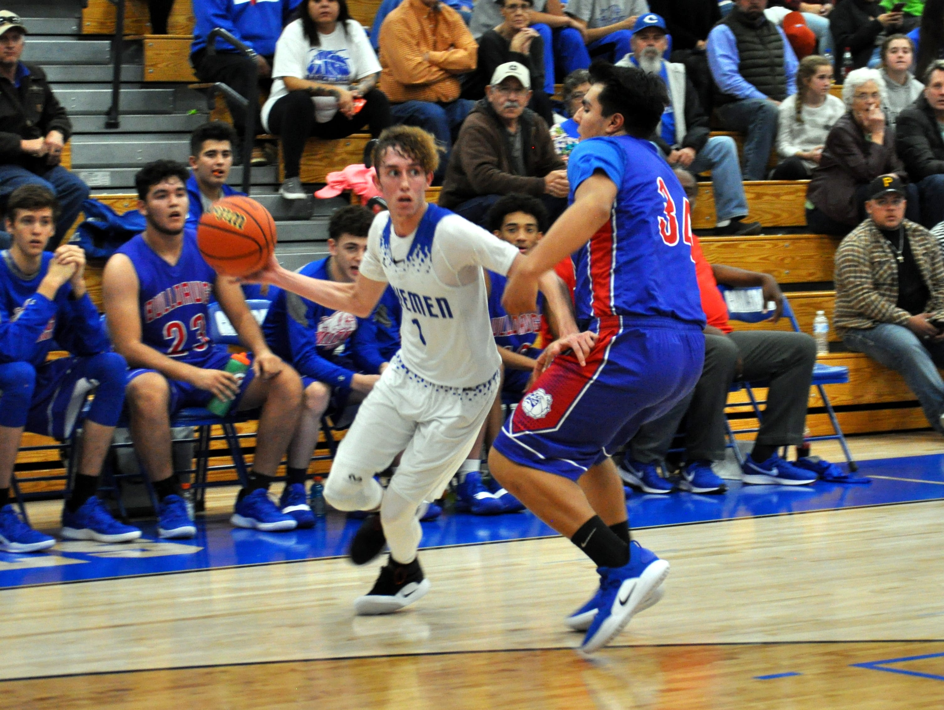 Josh Sillas looks for an open teammate during Friday's game against Las Cruces.
