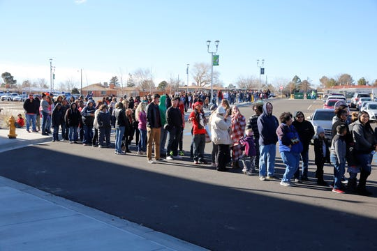 "People lined up and bundled up outside the Scorpion Arena Saturday to get a seat before the rally welcoming 16-year-old Farmington High School junior Chevel Shepherd back to Farmington following her win on NBC's ""The Voice."""