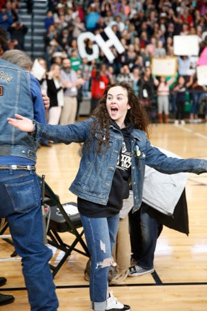 """Chevel Shepherd reacts after seeing a friendly face inside Scorpion Arena Saturday afternoon upon her homecoming from Los Angeles where, since early November, she has been shooting episodes of (and winning) NBC's """"The Voice."""""""