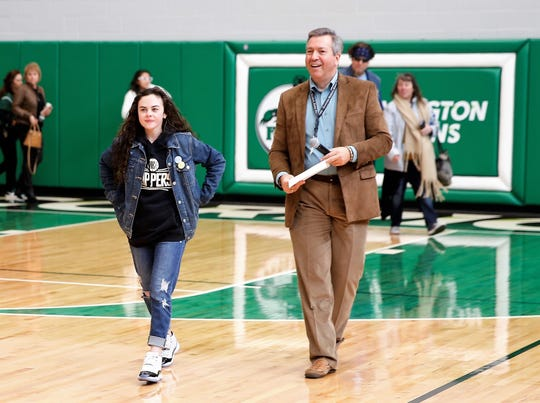 Chevel Shepherd is joined by emcee Scott Michlin on the floor of Scorpion Arena Saturday during her welcome home rally.