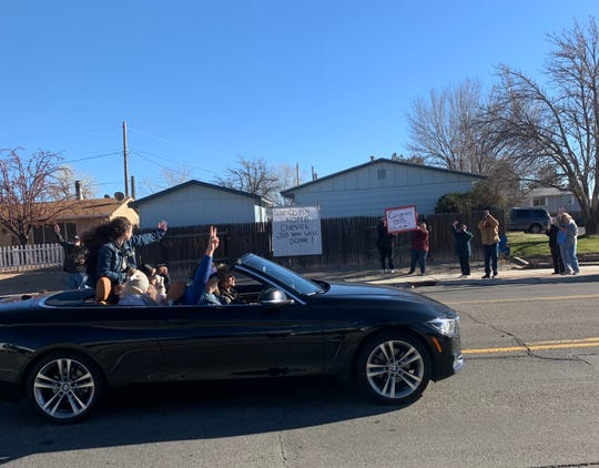 Chevel Shepherd's welcome home parade heading to Farmington High School passed by support banners and fans holding signs along 30th Street as it made its way to a rally in the Scorpion Arena.