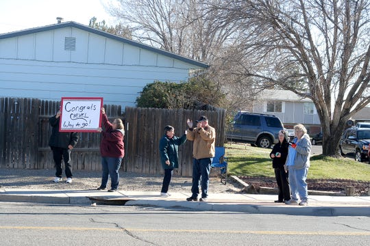 "Chevel Shepherd fans on 30th Street in Farmington watch as the convertible carriyng the 16-year-old winner of NBC's ""The Voice"" made its way past toward a homecoming rally at Farmington High School."