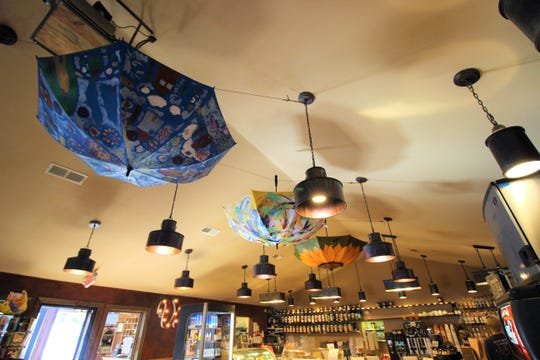 Upside down umbrellas hang in the restaurant bringing color and art to life.
