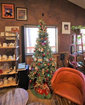 A Christmas tree standing in Sacred Grounds dining area brings color and lights to the holiday season.