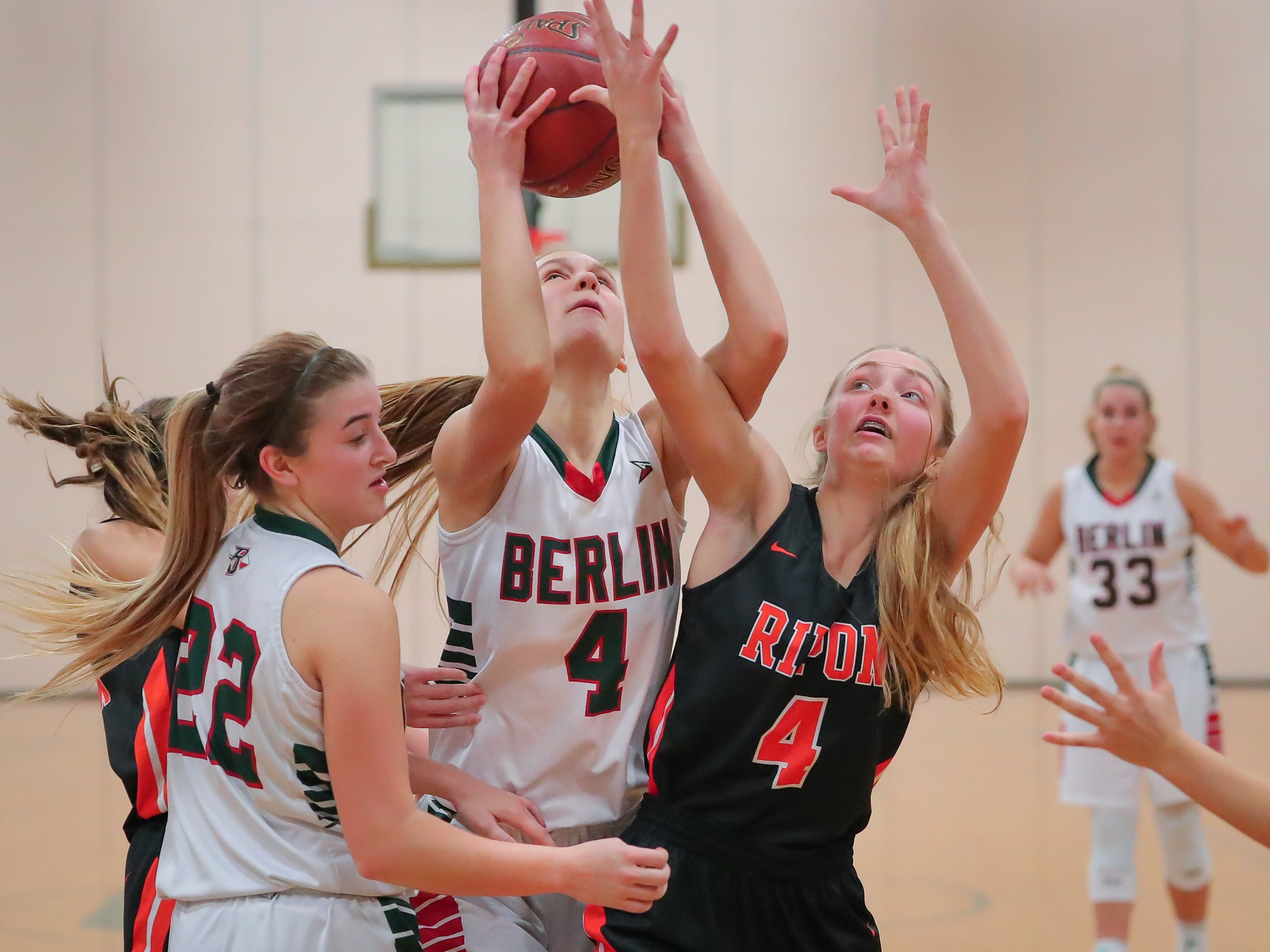 Olivia Bartol (4) of Berlin fights her way for a shot in the second half. The Berlin Indians hosted the Ripon Tigers in an East Central Conference girls basketball matchup Friday evening, December 21, 2018.