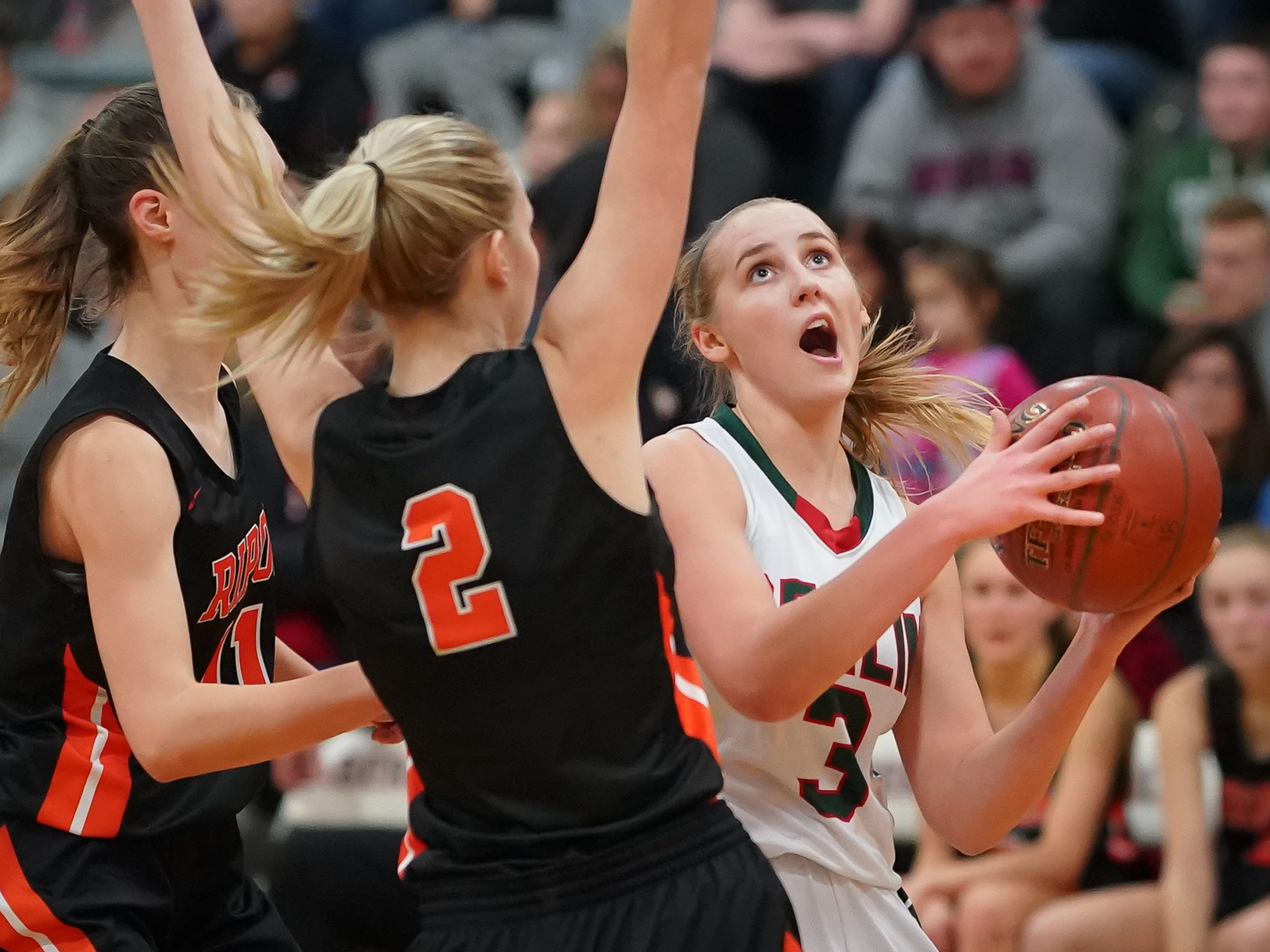 Myah Jodarski (3) of Berlin drives around Grace Burdick (2) of Ripon. The Berlin Indians hosted the Ripon Tigers in an East Central Conference girls basketball matchup Friday evening, December 21, 2018.
