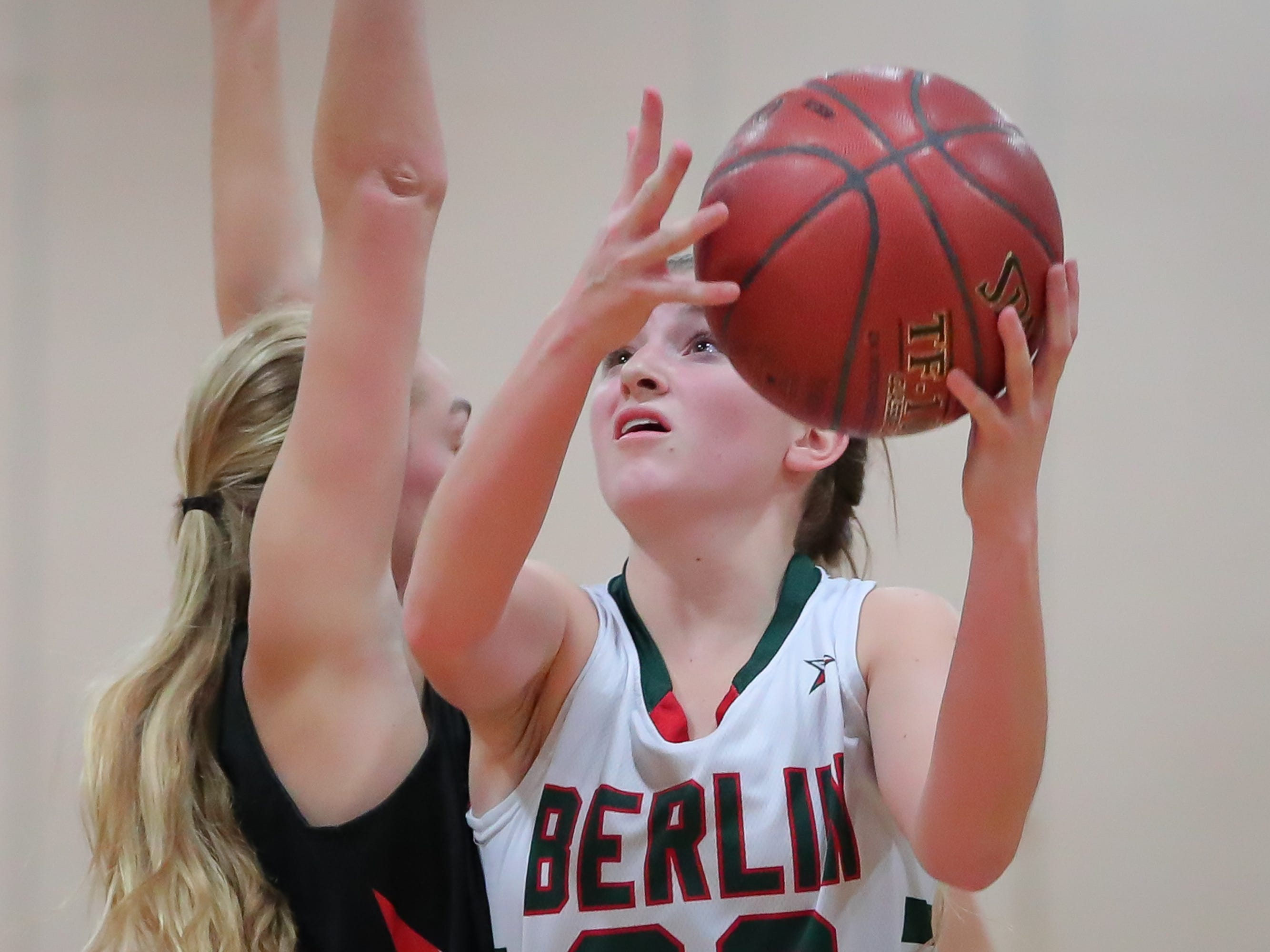 Mari Beltran (22) of Berlin goes up for a shot. The Berlin Indians hosted the Ripon Tigers in an East Central Conference girls basketball matchup Friday evening, December 21, 2018.