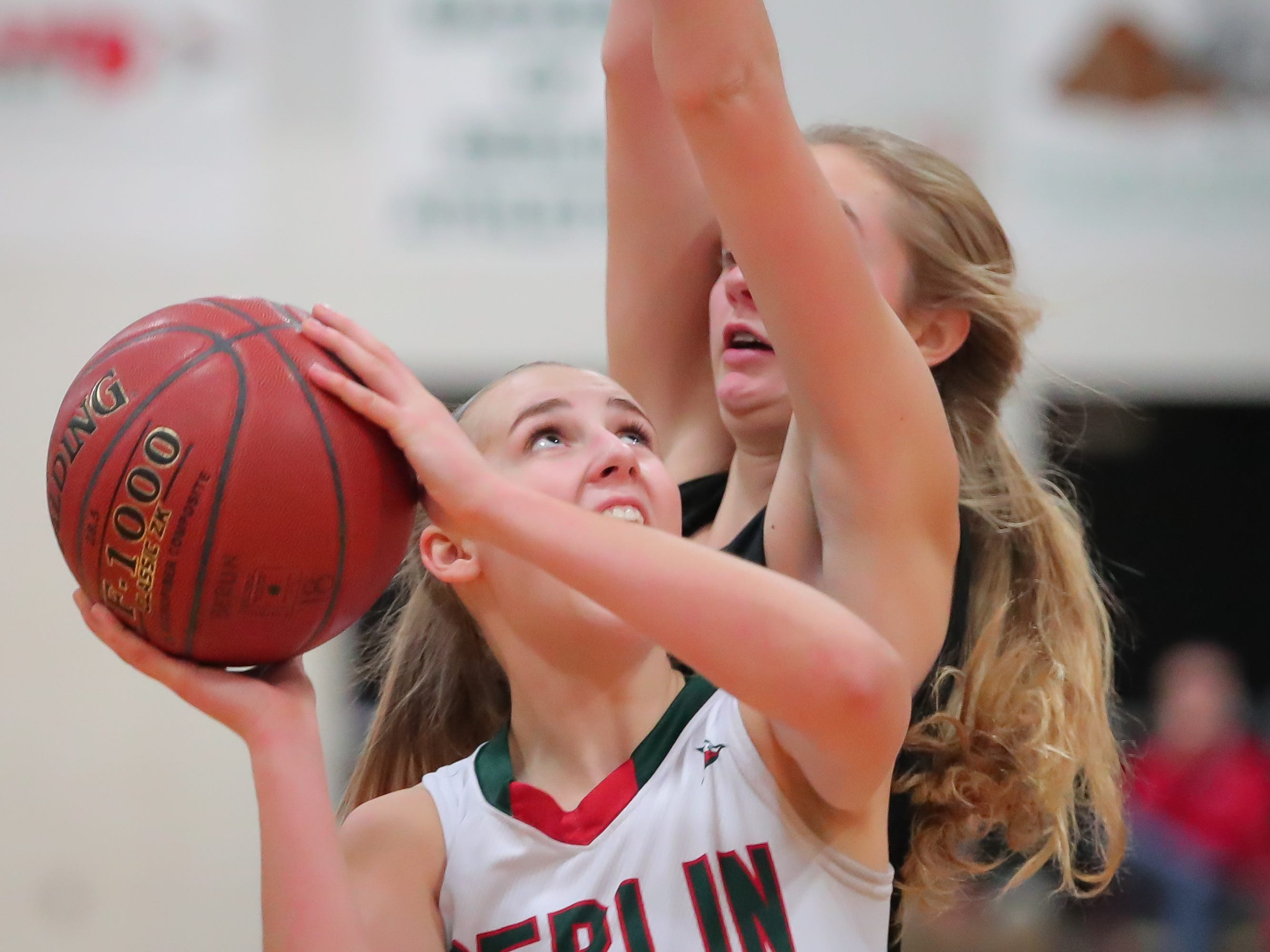 Myah Jodarski (3) of Berlin keeps her eye on the basket as she takes a shot. The Berlin Indians hosted the Ripon Tigers in an East Central Conference girls basketball matchup Friday evening, December 21, 2018.