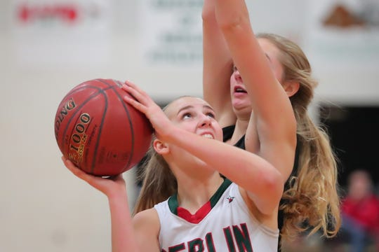 Myah Jodarski (3) of Berlin keeps her eye on the basket as she takes a shot against Ripon on Friday.