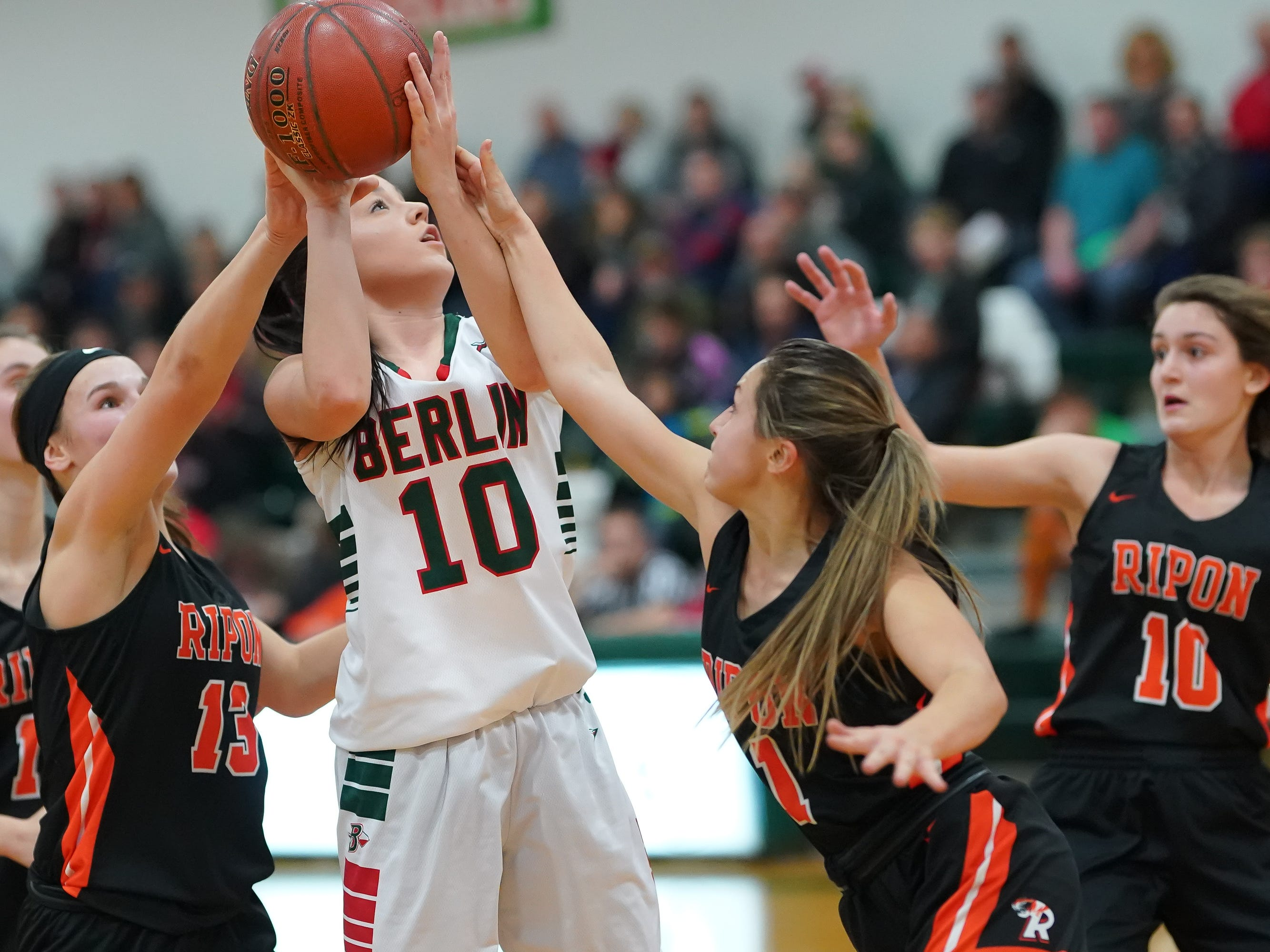 Kara Block (10) of Berlin tries to get a shot while double teamed. The Berlin Indians hosted the Ripon Tigers in an East Central Conference girls basketball matchup Friday evening, December 21, 2018.