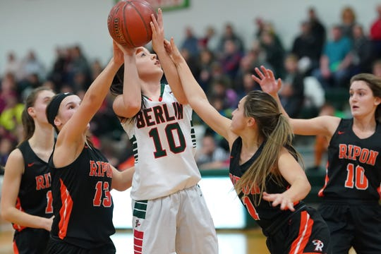 Kara Block (10) of Berlin tries to get up a shot while being double teamed against Ripon on Friday night.