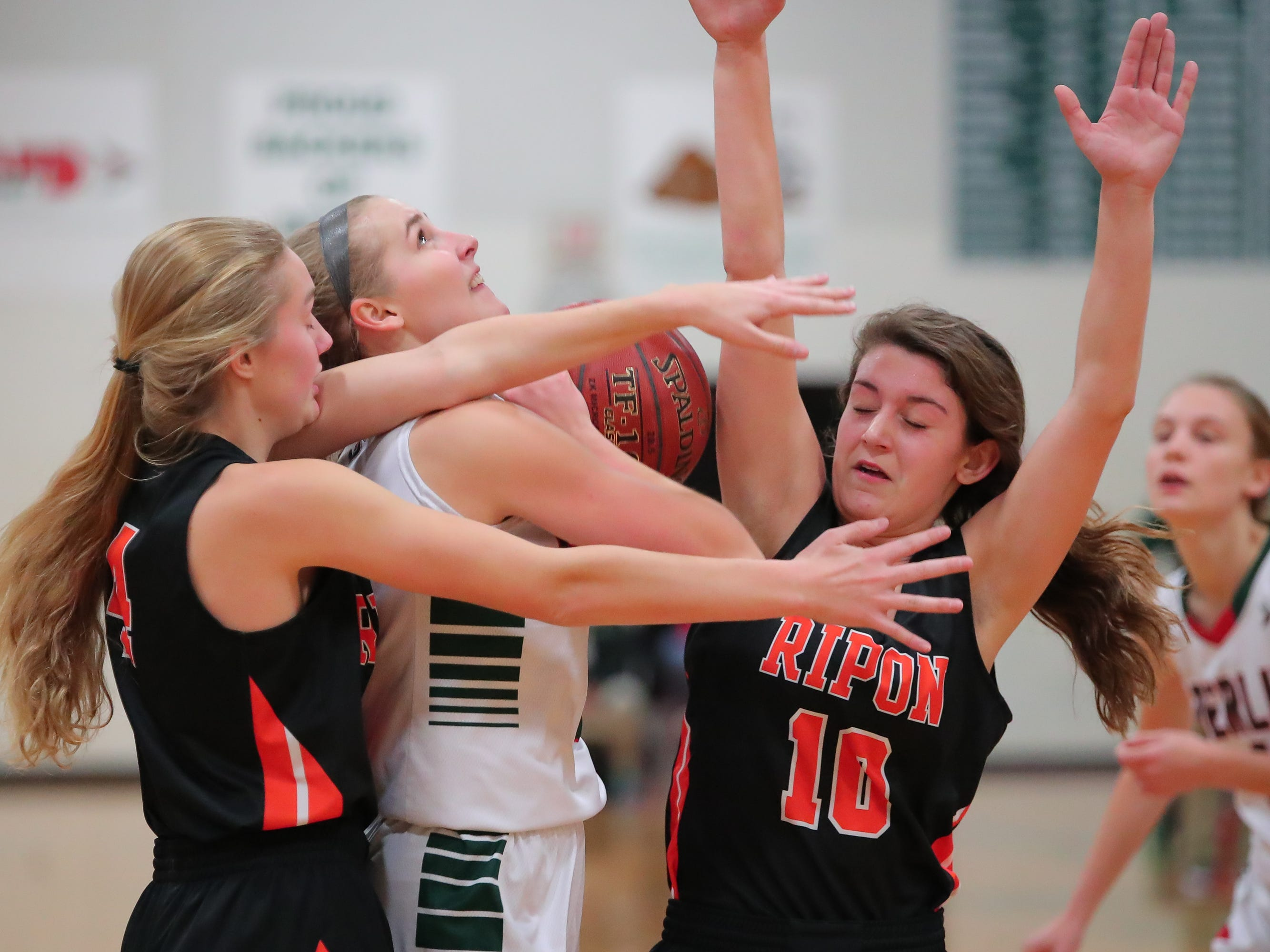 Myah Jodarski (3) of Berlin gets blocked by Elle Lewis (4) and Grace Rauch (10) of Ripon. The Berlin Indians hosted the Ripon Tigers in an East Central Conference girls basketball matchup Friday evening, December 21, 2018.