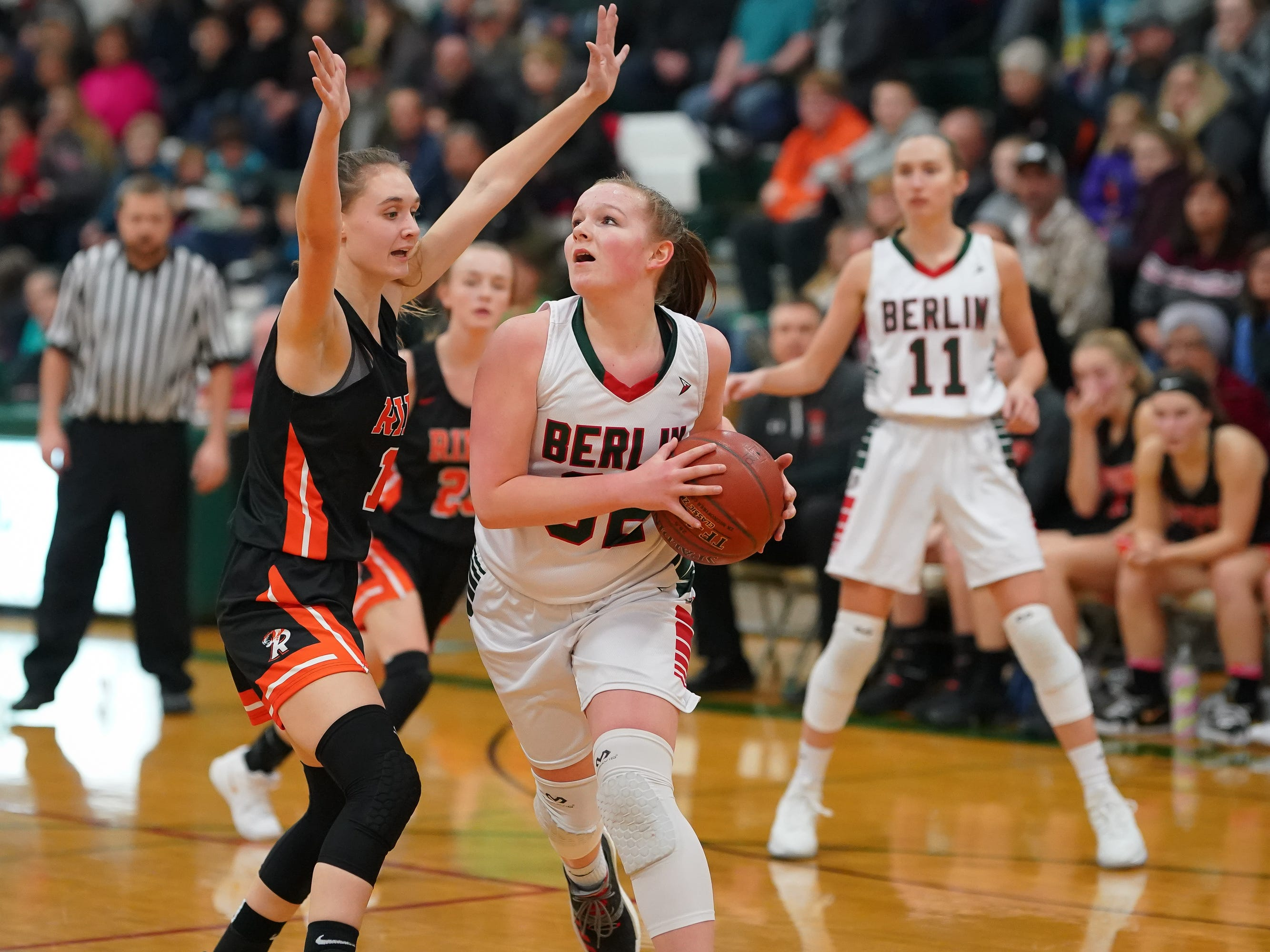 Jenna Sternitske (32) of Berlin drives around Alexa Miller (11) of Ripon. The Berlin Indians hosted the Ripon Tigers in an East Central Conference girls basketball matchup Friday evening, December 21, 2018.